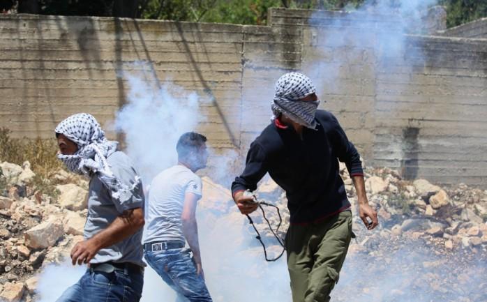إصابات بالرصاص والاختناق بعد قمع الاحتلال مسيرة منددة بالتطبيع